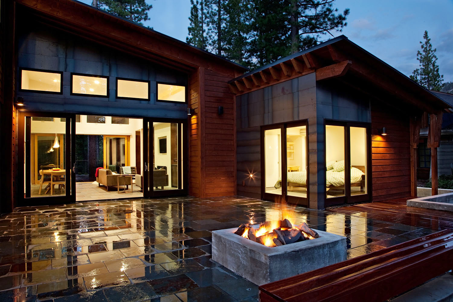 photo of Modern Home on a Mountain With Front Yard Tiling And Outdoor Fireplace