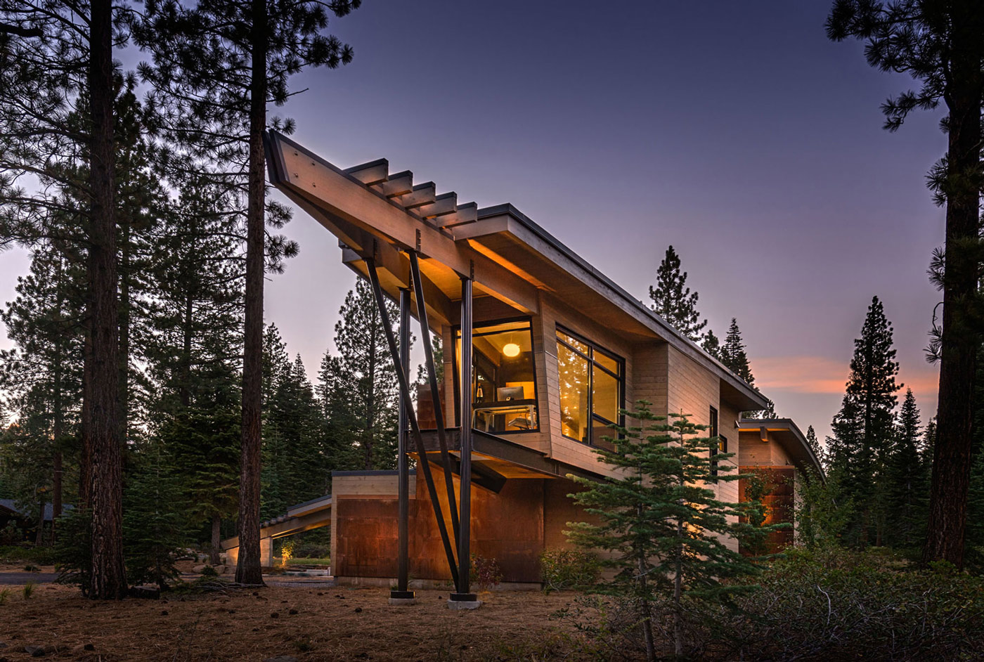 photo modern styled wood home taken at sunset
